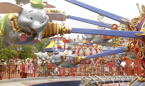 The new incarnation of the Dumbo the Flying Elephant ride at Magic Kingdom features two mirror-image carousels flying side-by-side.