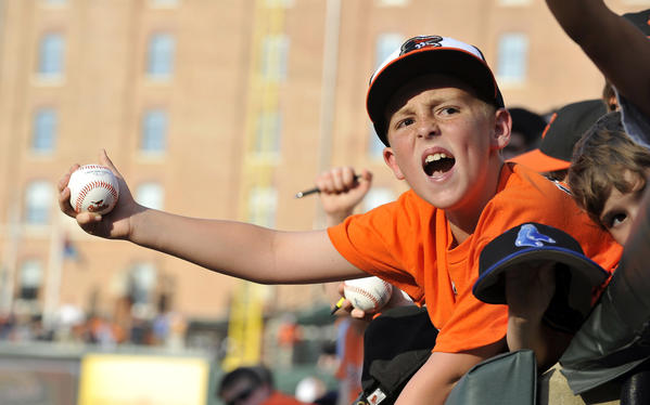 Conner Anders, 10, of Martinsburg, W.Va., tries to get an autograph before the Orioles face the Los Angeles Angels at Camden Yards Wednesday.