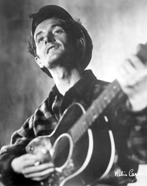"Dylan's musical idol.  Dylan traveled to New York in 1961 to visit the ""This Land is Your Land"" songwriter in the hospital.  He was suffering from Huntington's disease."