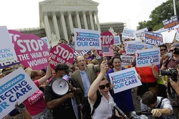 Supporters of the healthcare law celebrate outside the Supreme Court after the justices' ruling.
