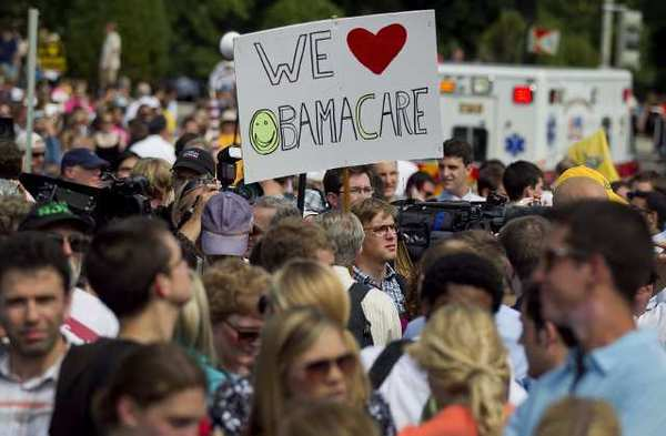 A supporter of the Affordable Care Act outside the Supreme Court building after the court's ruling in Washington, D.C. on Thursday.