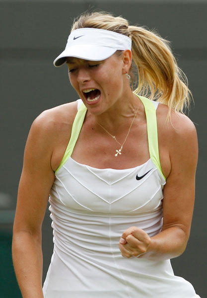 Maria Sharapova of Russia reacts during her women's singles tennis match against Tsvetana Pironkova of Bulgaria at the Wimbledon tennis championships in London June 28, 2012.