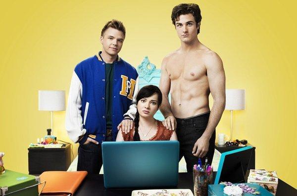 "Brett Davern, left, as Jake with Ashley Rickards as Jenna and Beau Mirchoff as shirtless Matty of MTV's ""Awkward."""