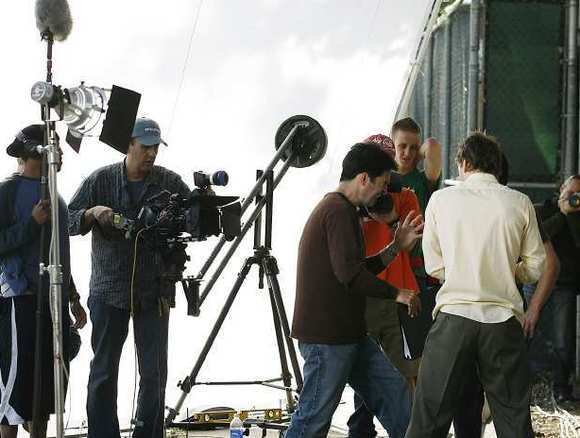 Director Eric Tozzi, center, works with actor Bryan McClure and Jared Day while shooting a scene for a short called Bountyful on a CSB Studios lot on Friday, Feb. 12, 2010.