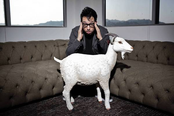 Seb Webber leads the artist management firm SQE, handling management, PR, record label and licensing for a select group of clients. He is shown with the firm's mascot goat in their new headquarters in Hollywood.