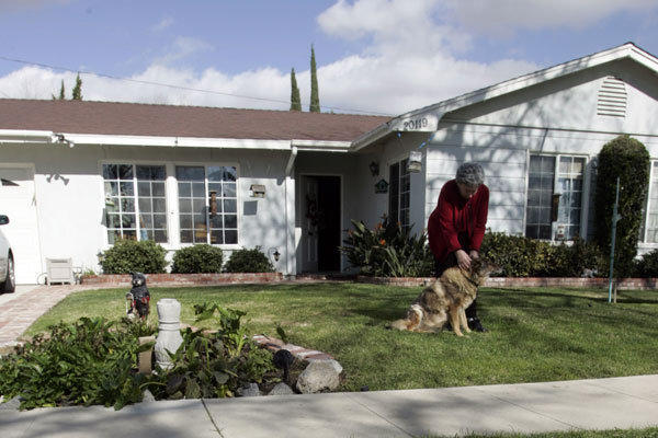 Longtime Chatsworth resident Betty Jenkins with her dog. Jenkins used a reverse mortgage to pay off a mortgage on the home she has lived in for 20 years.