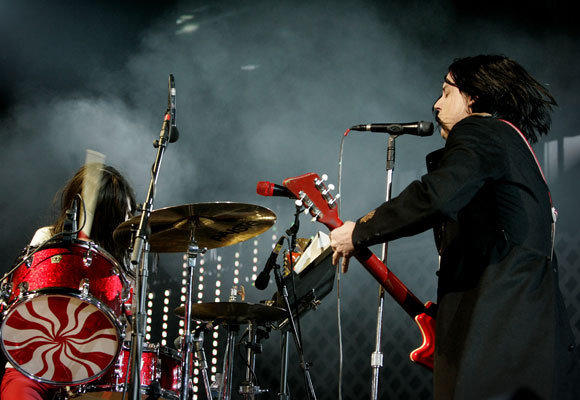 The White Stripes -- Meg and Jack White -- perform at the KROQ Almost Acoustic Christmas concert at the Gibson Amphitheatre at Universal City Walk on Dec. 11, 2005.