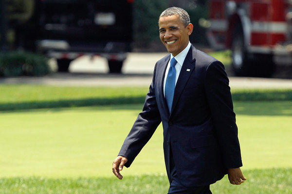 President Obama walks across the South Lawn after learning the Supreme Court's decision on his healthcare package.