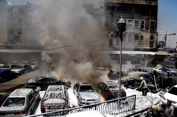 A photo provided by Syria's state-run news agency shows the aftermath of a bombing at a judicial complex in Damascus.