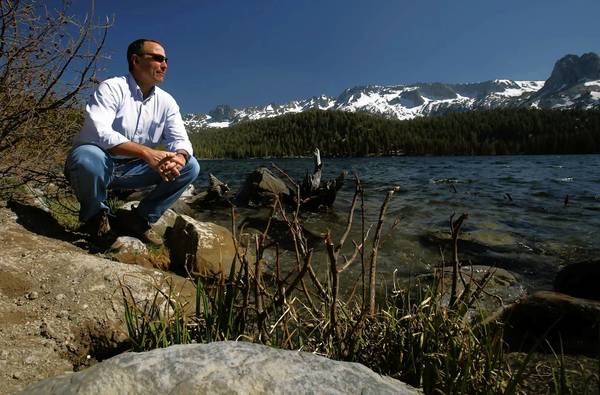 Greg Norby, general manager of the Mammoth Community Water District, visits one of his favorite spots on the shore of Lake Mary. The Mammoth Community Water District says that if it loses lawsuits filed by the Los Angeles Department of Water and Power for control of Mammoth Creek, it would have to buy water from the DWP. That would force the district to raise average rates to levels many locals cannot afford, officials say.