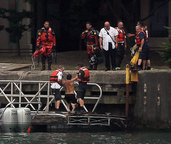 A swimmer is pulled out of the Chicago River near Lake Shore Drive and Wacker Drive.