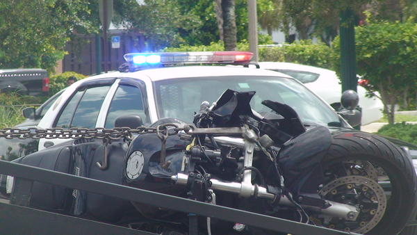 A motorcyclist was ejected when he struck a pickup truck in Davie