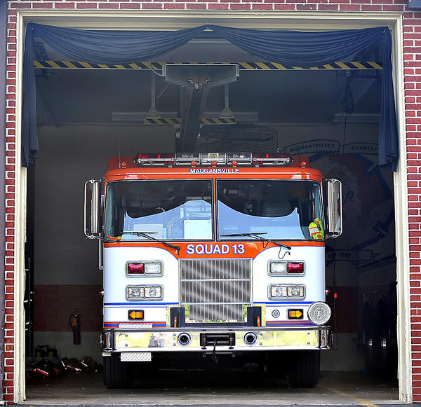 A black sash hangs over the engine bay at Maugansville Goodwill Volunteer Fire Co. Thursday in remembrance of Washington County Emergency Medical Services Director Brigitte Heller, who died Thursday of injuries from a June 14 traffic accident.