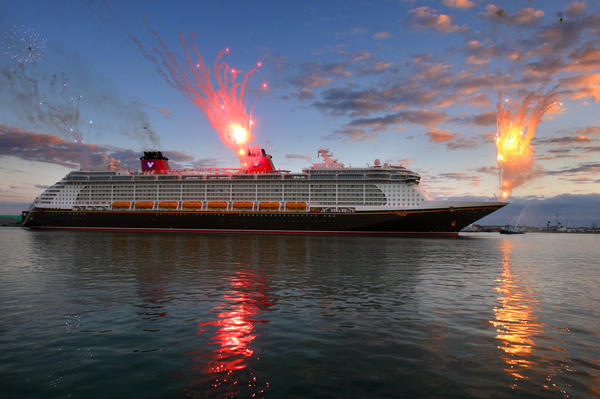 Fireworks blast off from the Disney cruise ship Fantasy as it arrives at Port Canaveral, Tuesday, March 7,  2012, at sunrise.
