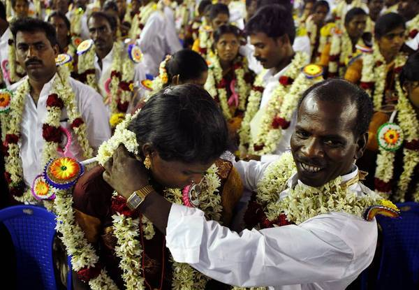 A couple take part in a mass marriage ceremony this month in Chennai. Marriages in India, 90% of which are arranged, are more a merging of clans than a union of two people.