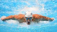 "<strong>—</strong> <a href=""/bal-phelps,0,4148779.storygallery"">Michael Phelps</a> added a third event to his London lineup Thursday night, powering ahead in the final leg to win the 200-meter butterfly race at the Olympic swimming trials — and also, in a sense, to touch home."