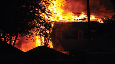 Firefighters from four departments rushed to contain a fire to this two-story home along West Catherine Street in Somerset Borough Thursday night. The fire set off several explosions and could be seen from several blocks away.