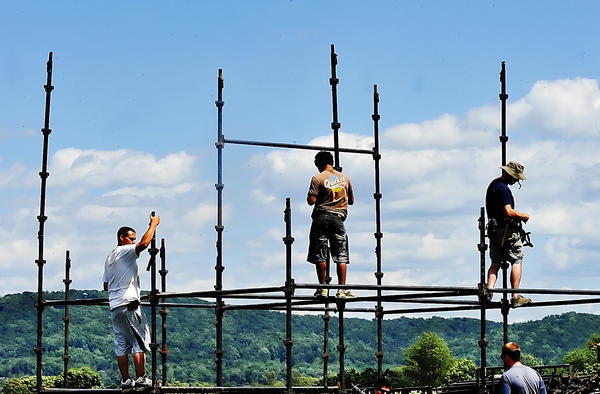 Workers put up scaffolding Wednesday for the stage that will hold the Maryland Symphony Orchestra for the July 7 Salute to Independence celebration at Antietam National Battlefield.