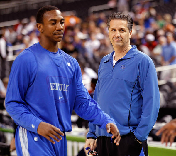 Marquis Teague with Kentucky coach John Calipari.