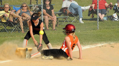 Grace Miller slides safely into third as Cassandra Sanzi tries to make a play Thursday in the Laurel Highlands Major League Softball championship game.