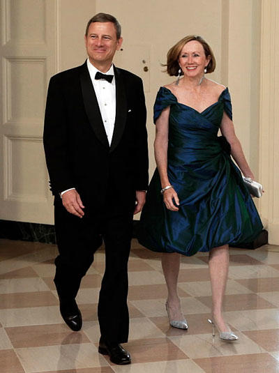Chief Justice John Roberts and his wife, Jane, arrive for a state dinner for German Chancellor Angela Merkel at the White House in Washington, D.C., in this June 7, 2011, file photo.