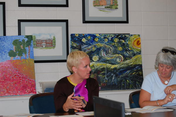 Danville Independent Schools Superintendent Carmen Coleman, left, and Board of Education Chairwoman Jean Crowley listen to a 2012-13 budget presentation during a special Board of Education meeting Thursday. (Stephanie Mojica/smojica@amnews.com)