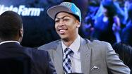 NEWARK, N.J. (AP) — Anthony Davis hugged his college teammate, hugged his coach, and climbed on stage as the No. 1 pick.