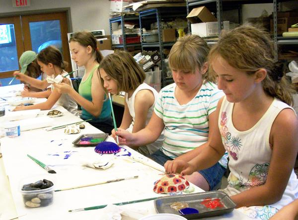 Boyne City Middle School students, (front to back) Raeanna Watkins, Jenna Urman, Erin Brodie, Emmy Washburn, Sara Evens and Alexis Weaver, work on their art project while visiting Crooked Tree Arts Center as part of their 21st Century summer experience.