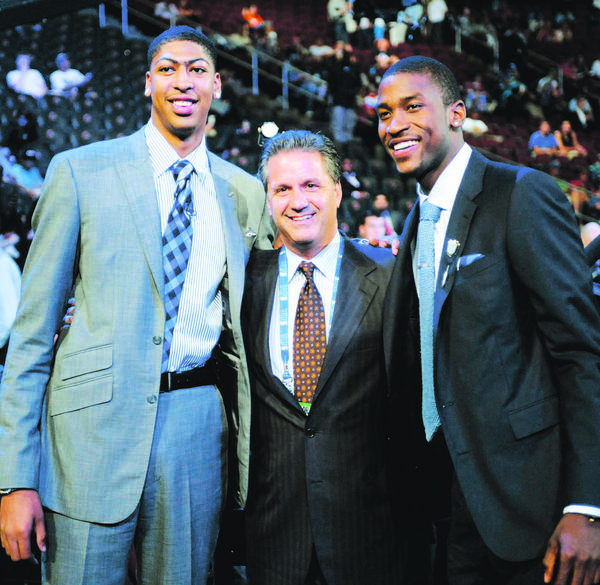 Kentucky coach John Calipari, center, smiles along with former players Anthony Davis, left, and Michael Kidd-Gilchrist at the NBA draft Thursday. Davis was selected the No. 1 overall pick by the New Orleans Hornets, and Kidd-Gilchrist was selected No. 2 by the Charlotte Bobcats ¿ the first time players from the same team have gone one-two in the draft.