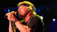 "A family friend of <span class=""runtimeTopic"">Bob Seger</span> has been arrested in connection with the theft last August of a Gibson guitar, Rolex watch and other items from the Rock and Roll Hall of Famer's home. Police allege 20-year old Andrew W. Thompson snuck back into the house after a party thrown by Seger¿s 16-year old daughter. On Tuesday, Thompson was charged with larceny and released on bond. Thompson admits stealing the Rolex, autographed Shaquille O¿Neal sneakers and cash, but denies taking the 1978 Gibson <span class=""runtimeTopic"">Les Paul</span> Seger is holding on the cover of the 1994 Greatest Hits album."