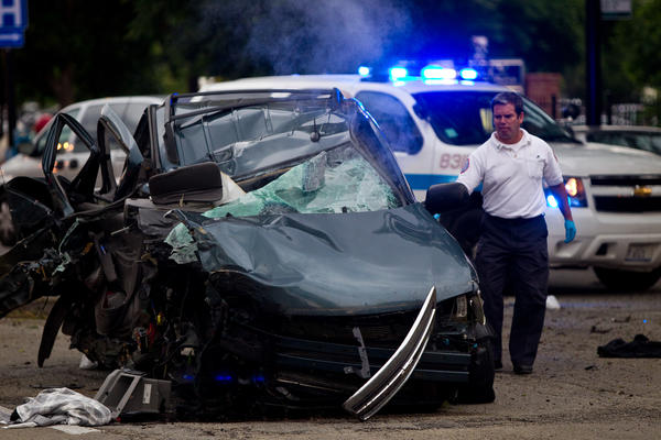 A vehicle traveling on South Michigan Avenue hit a tree at 26th Street Friday.