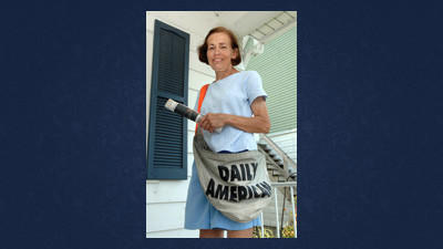 Judy Custer retires after 37 years as a Daily American newspaper carrier.