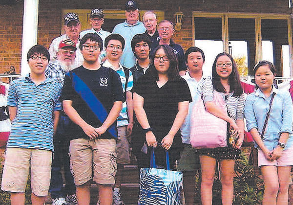 Members of Korean War Veterans Antietam Chapter 312 are shown with a group of students from Northern Virginia high schools.