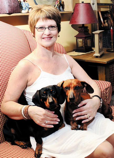 Robin Kellick of Williamsport is seated with her dogs, Norman and Toby. Kellick was diagnosed with fibromyalgia more than 10 years ago. She says that she has had to learn to take time out for herself.