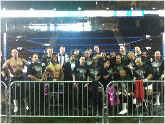 Arda Ocal is fifth from right in the second row, wearing a suit. Many familiar faces were in attendance, including former WWE superstar Shawn Spears (second from right in back row), and tag team the Flatliners (far left and second from left in second row).