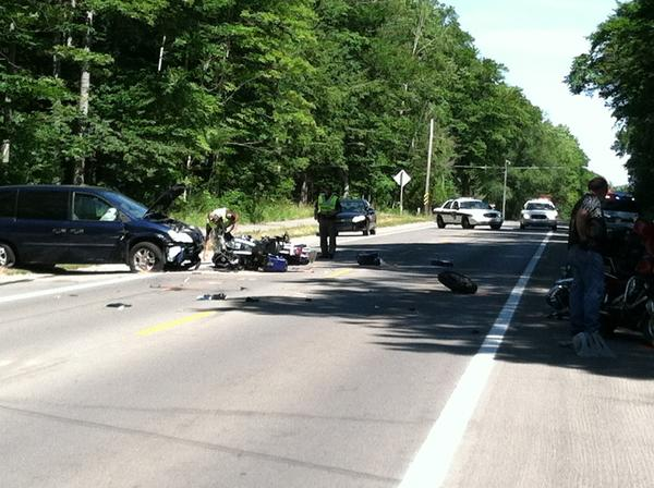 Officials at the scene of a crash on M-119 north of Pleasantview Road today, Friday.