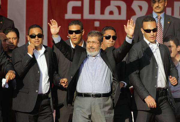 Egyptian President-elect Mohamed Morsi waves to supporters Friday at a protest in Cairo's Tahrir Square.