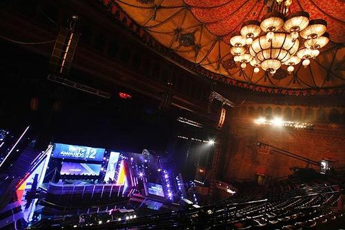 "A view from the balcony level at the Shrine Auditorium in Los Angeles shows the stage for the 2012 BET Awards during a rehearsal on June 28. Since 2006, the BET Awards have been housed at the Shrine Auditorium, but they will move to the Nokia Theatre L.A. Live downtown next year and expand to a three-day event, the ""BET Awards Experience."""