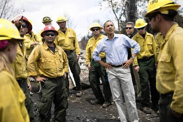 President Obama talks with firefighters on a visit to the destroyed Mountain Shadow neighborhood of Colorado Springs, Colo.