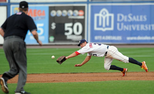 Lehigh Valley IronPigs' infielder Kevin Frandsen (3) tries to dive for a ground ball at second base throws onto first base during their game with the Rochester Red Wings at Coca-Cola Park in Allentown Friday night.