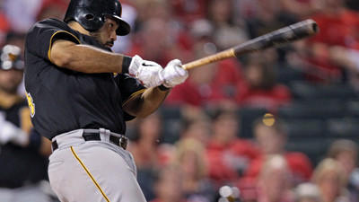 Pittsburgh Pirates' Pedro Alvarez swings on a three-run double in the fifth inning against the St. Louis Cardinals on Friday night.