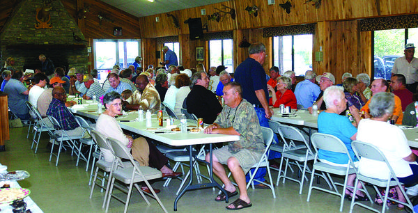 Members of the Clark County Fish and Game Club dine and socialize at a recent meeting.