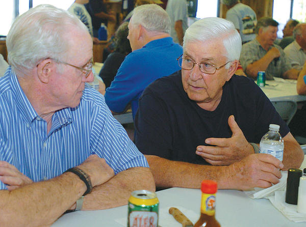 Clifford McCuddy, left, and fellow Clark County Fish and Game Club member Brinston Muncie, right, enjoy a conversation before dinner and a board meeting. Members enjoy a period of fellowship and a potluck meal before the monthly meeting.