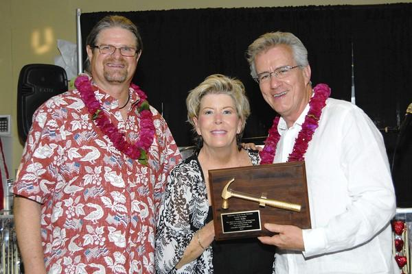 The Golden Hammer Award was presented to Master of Ceremonies Peter Buffa, right. Also picture are, from left: Event Chairperson and SCSK Board Member Dan Hamilton and SCSK President Teri Hatleberg.