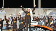 SPARTA (AP) — Austin Dillon lived up to the legend of the No. 3 car, then had his victory called into question Friday night.