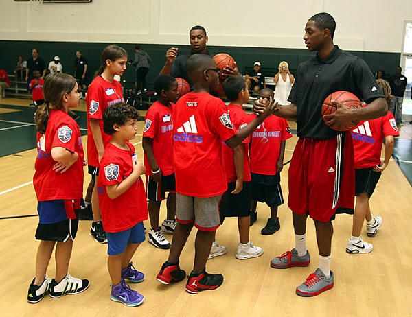 Brandon Knight huddles with the kids at his camp.  Former Pine Crest star and now NBA Detroit Piston Brandon Knight is hosting a youth camp at his alma mater, Pine Crest.