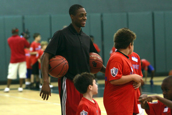Brandon Knight jokes with the kids at his camp.