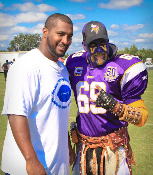 Daunte Culpepper, and Trey Miller of Orlando take a photo together at the Orlando Youth Football Clinic at Thunder Field in Orlando, FLA. on June 30, 2012.