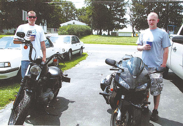 Zane Cook and his younger brother, Derek, pose for this picture taken in the summer of 2009. The brothers shared many interests, and motorcycles was one of them.