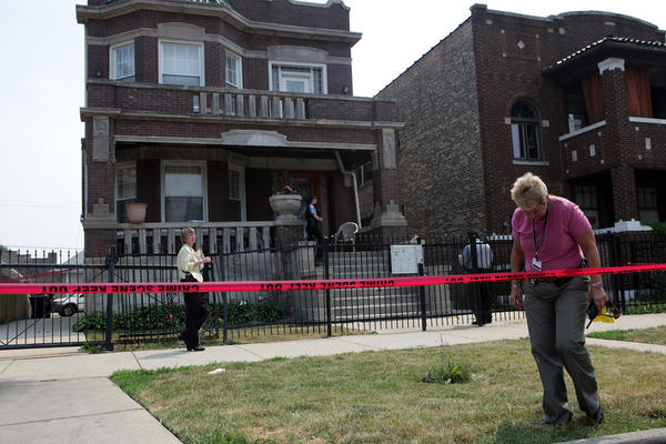 Members of the Chicago Police Department investigate the scene of a fatal shooting in the Austin neighborhood.